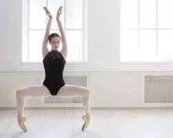 ballerina posing in dance studio