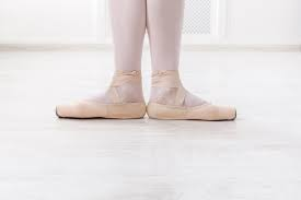 close up of ballerinas feet pointing out