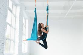 female hanging on silk fabric dance posing