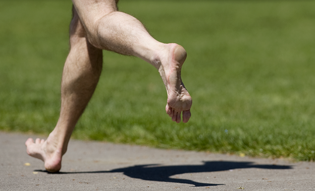 man running bare feet